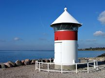 Lighthouse in Assens Denmark. Port lighthouse at the port of Assens Denmark Royalty Free Stock Photography