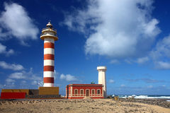 Lighthouse on atlantic coast. Under sky with clouds Royalty Free Stock Photos