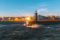 Lighthouse on the Atlantic coast at sunset, Porto. Stock Images