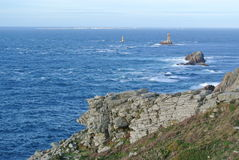 Lighthouse in the Atlantic Ocean. At Point du Raz in Brittany Stock Photos