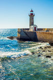 Lighthouse by the Atlantic ocean Stock Images