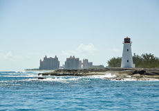 Lighthouse and Atlantis. Lighthouse of the island of Nassau Bahamas with the luxury resort Atlantis in the background Royalty Free Stock Photos
