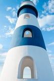 Lighthouse background. Lighthouse against the sky sunny day Royalty Free Stock Photos