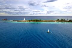 The Lighthouse - Bahamas. The sail boat passes by lighthouse in Nassau Bahamas Stock Images