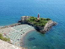 Lighthouse of Baia. Baia, Naples, Campania, Italy - June 16, 2018: Panoramic glimpse from the terrace of the Aragonese castle Royalty Free Stock Images