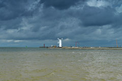 Lighthouse on Baltic coast. Image was taken on August 2012 in Baltic sea port Swinoujscie, Poland, Europe Stock Image