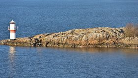 Lighthouse in Baltic Sea. Early spring. Sweden, archipelago of Stockholm Royalty Free Stock Image