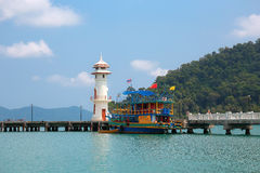 Lighthouse on a Bang Bao pier on Koh Chang Island in Thailand Stock Photo