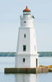 Lighthouse in the bay 2. A lighthouse in the bay outside a small port Royalty Free Stock Images