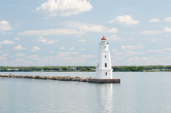 Lighthouse in the bay. A lighthouse on the rocks in the bay Stock Images