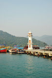 Lighthouse In Bay On Koh Chang Island, Thailand. White lighthouse and pier in bay on Koh Chang island Thailand Royalty Free Stock Image