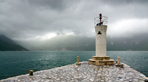 Lighthouse on the Bay of Kotor. Lighthouse on the island of Lady of the Rocks, on the Bay of Kotor, Montenegro Royalty Free Stock Photo