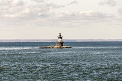 Lighthouse in the bay near town of Orient. USA Royalty Free Stock Photo