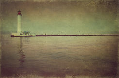 Lighthouse in the bay (vintage style) Royalty Free Stock Images