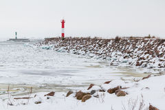 Lighthouse on the Bay in winter. Lighthouse on the shore of the Gulf of Finland in winter scene Royalty Free Stock Photos