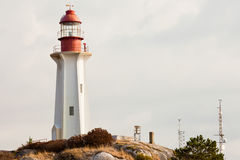 Lighthouse BC West Coast Canada granite rock cliff Royalty Free Stock Photo