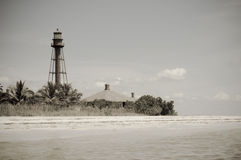Lighthouse by the beach. Lighthouse standing in a tropical beach stock photo