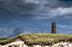 Lighthouse and beach Stock Photography
