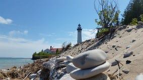 Lighthouse. Beach and a lighthouse Stock Photos
