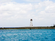 Lighthouse on the beach in a beautiful day Royalty Free Stock Image