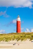 Lighthouse and beach of De Cocksdorp on Texel island, Netherland Royalty Free Stock Photo