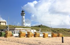 Lighthouse and beach in Egmond aan Zee. North Sea, the Netherlands. The J.C.J. van Speijk Lighthouse is a lighthouse on the North Sea coast near Egmond aan Zee royalty free stock photo