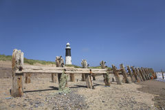 Lighthouse and beach groynes. At Spurn Point, East Yorkshire Royalty Free Stock Image