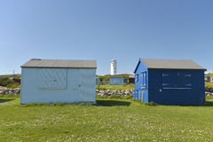 Lighthouse and beach huts at Portland Bill Royalty Free Stock Photography