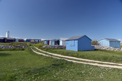 Lighthouse and beach huts at Portland Bill Royalty Free Stock Photo