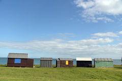 Lighthouse and beach huts at Portland Bill Stock Photography