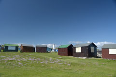 Lighthouse and beach huts at Portland Bill Stock Images
