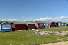 Lighthouse and beach huts at Portland Bill Royalty Free Stock Photos