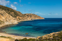 Lighthouse and beach at Revellata in Corsica Stock Photos