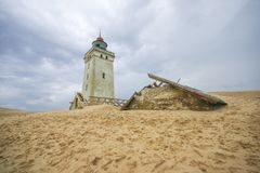 Lighthouse on the beach in rubjerg knude stock image