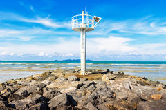 Lighthouse at beach on summer Stock Image