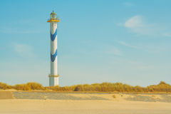 Lighthouse at the beach Royalty Free Stock Image