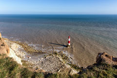 Lighthouse at Beachy Head, East Sussex, United Kingdom. Lighthouse and steep chalk cliffs at Beachy Head, East Sussex, United Kingdom Royalty Free Stock Photography