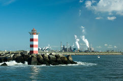 Lighthouse beacon. Over factory with smoke Royalty Free Stock Photography