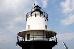 Lighthouse Beacon against a blue sky. Top of a Lighthouse Beacon against a blue summer sky stock photo