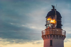 Lighthouse beacon at dusk. Beacon of the lighthouse at Dunnet Head at dusk Royalty Free Stock Photo