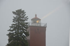 Lighthouse beacon in the fog Stock Photography