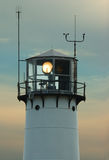 Lighthouse with beacon shining Stock Photos
