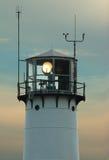 Lighthouse with beacon shining. Early twilight Stock Photos