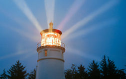 Lighthouse Beams Illumination Into Rain Storm Maritime Nautical Royalty Free Stock Images