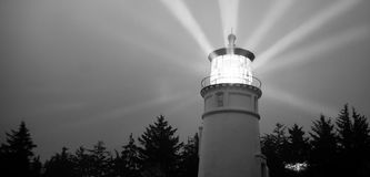 Lighthouse Beams Illumination Into Rain Storm Maritime Nautical Stock Photos