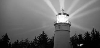 Lighthouse Beams Illumination Into Rain Storm Maritime Nautical Stock Photos