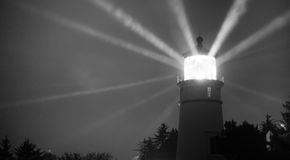 Lighthouse Beams From Lens Rainy Night Pillars of Light Royalty Free Stock Photography