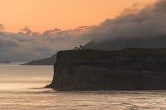 Lighthouse at beautiful Faeroe islands, summer time Stock Photos