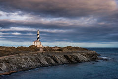 Lighthouse. Beautiful and mysterious lighthouse in a cloudy day Stock Image