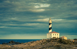 Lighthouse. Beautiful and mysterious lighthouse in a cloudy day Royalty Free Stock Photos